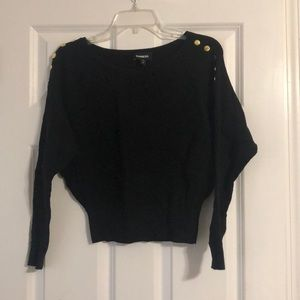 Black express crop sweater with gold buttons.